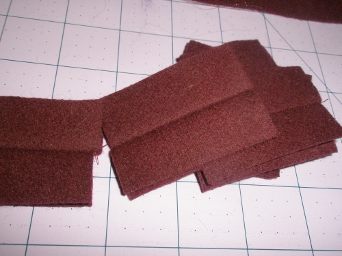 cut rectangles 2 by 1.5 inches, 2 for each buttonhole. RST sew two together with a long basting stitch, right down the center. Open and press so that right sides are showing