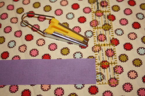 cut  a narrow  strip of fabric